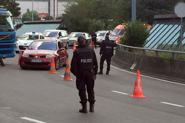 Swiss-police-check-cars-at-entrance-of-t